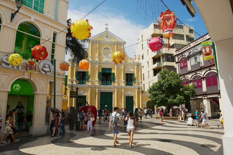 Tourists walk in front of the St. Dominic`s Church in Macau, China. stock photography