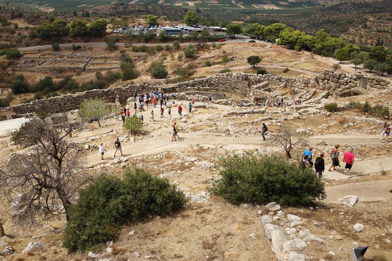 Tourists walk through the Lion`s Gate of Mycenae citadel stock images