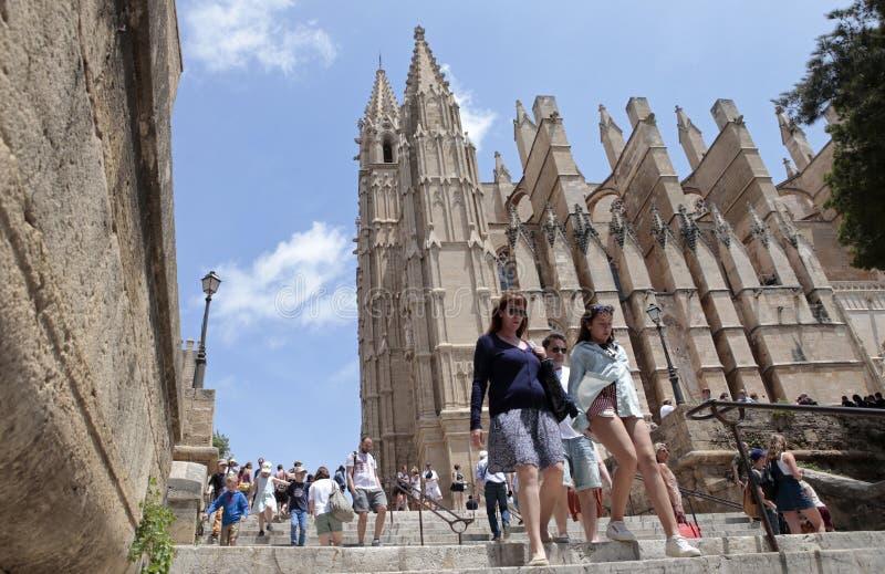 Tourists walk near Palma de mallorca´s cathedral stock photography