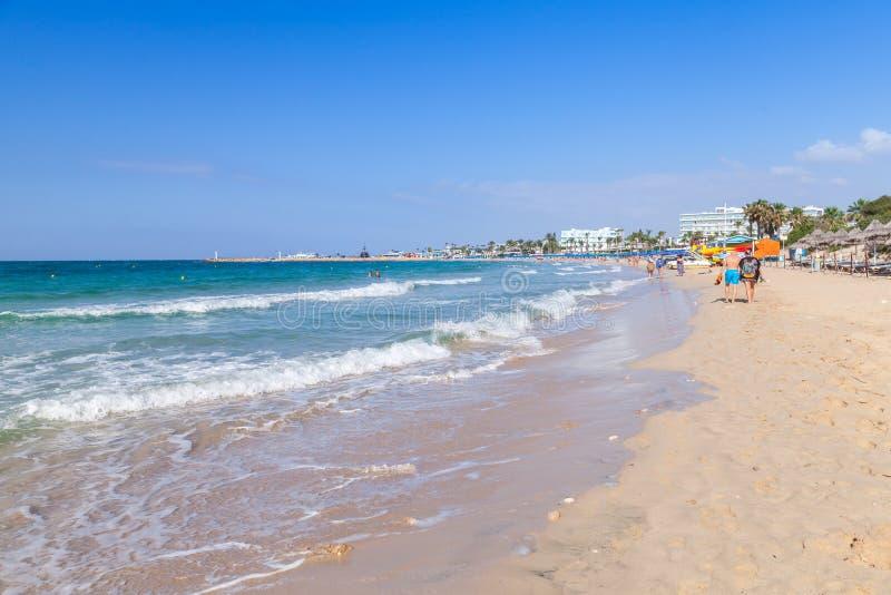 Tourists walk on public beach of Ayia Napa stock images