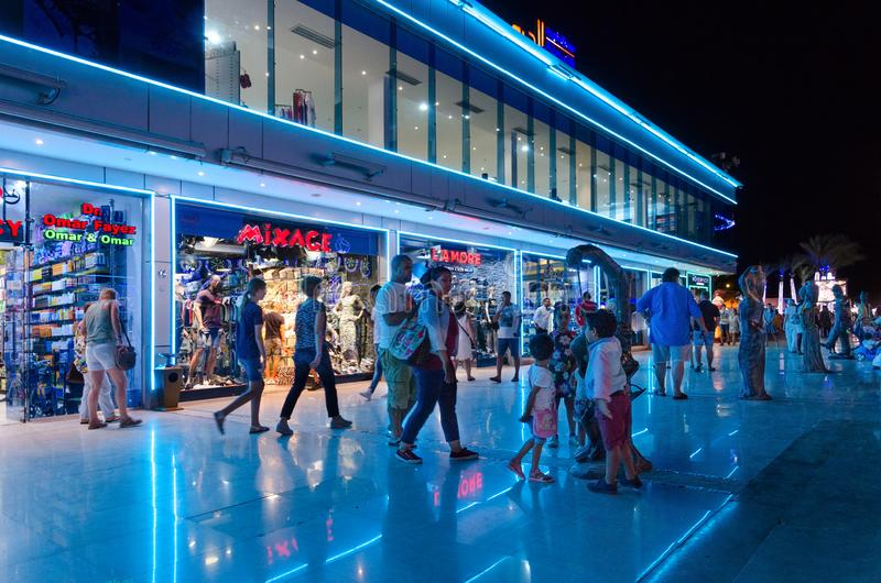 Tourists walk in shopping and entertainment district of Soho Square in evening, Sharm El Sheikh, Egypt royalty free stock photo