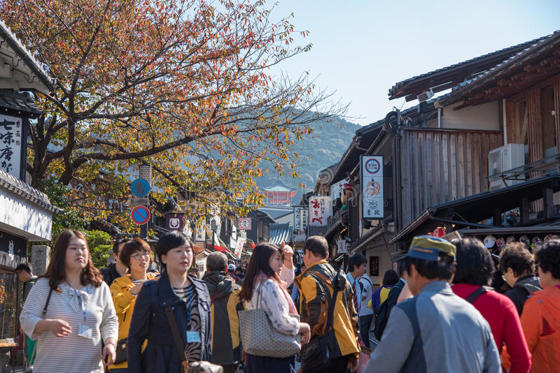 Tourists walk on a street around Kiyomizu Temple stock images