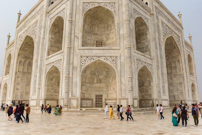 Tourists walking around the Taj Mahal in Agra royalty free stock photography