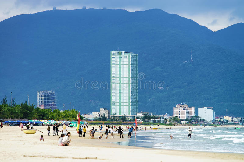 Tourists walking at the China Beach in Danang in Vietnam royalty free stock image