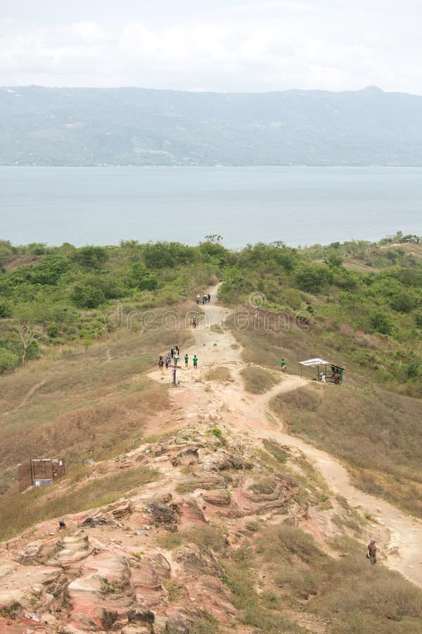 Tourists walking hiking trekking tour trail to Taal volcano, Batangas, Philippines.  stock photos
