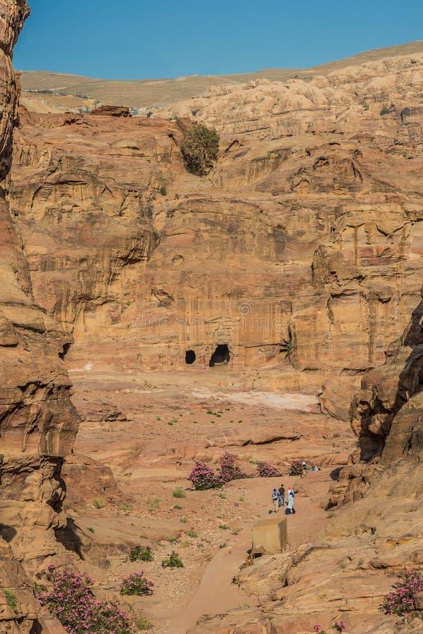 Tourists walking in nabatean city of  petra jordan
