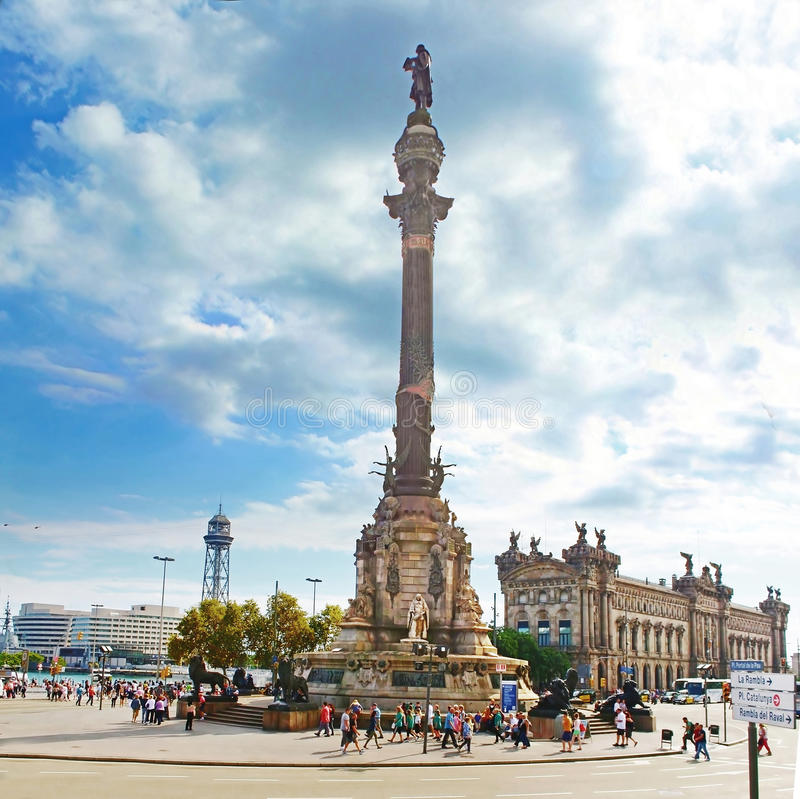 Tourists walking near Columbus monument in Barcelona, Spain stock photo