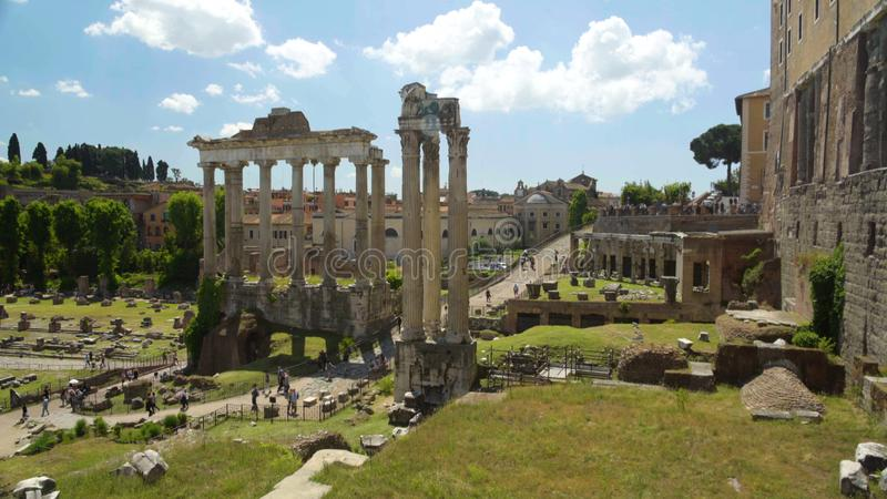 Tourists walking in open-air museum Roman Forum, view from Capitolium Hill stock photography