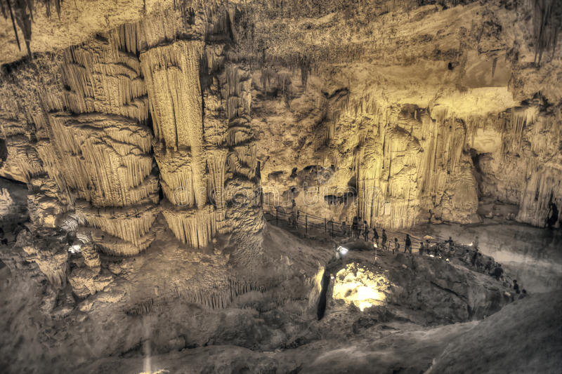 Tourists Walking On  Stalactites Cave Looking Infernal Editorial Stock Image