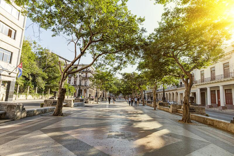 Tourists are walking on street of Old Havana in Havana, Cuba. Main street in Havana downtown. paseo del prado, de marti. Tourists are walking on the street of stock images