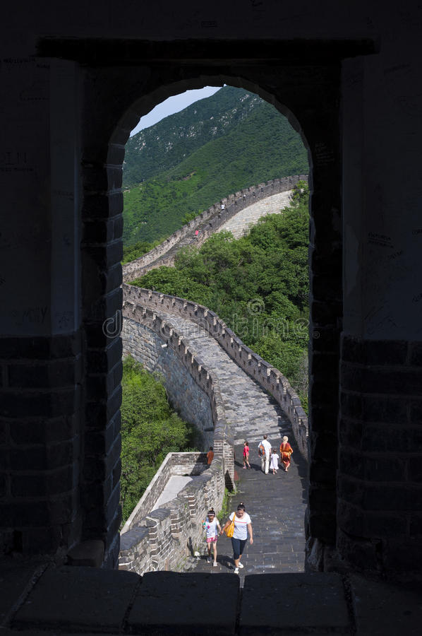 Tourists walking in a stretch of the Great Wall of China in Mutianyu, China royalty free stock photo