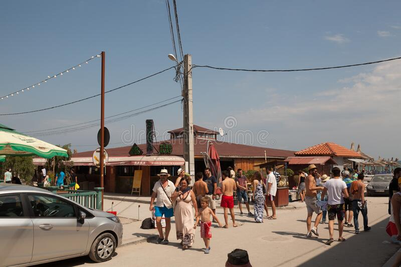 Tourists walks in Vama Veche royalty free stock image