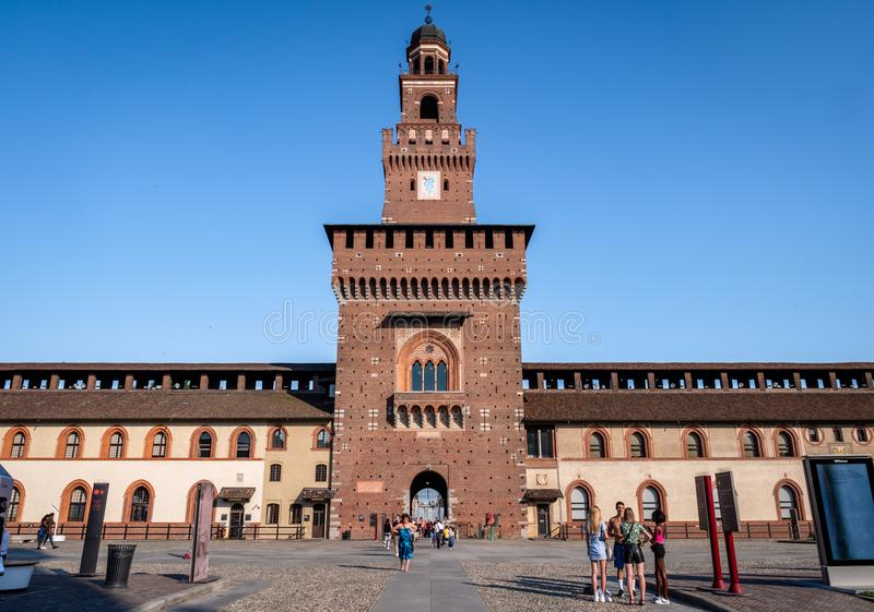 Tourists wandering around the famous Medieval 15th Century Sforza Castle Fortress in the heart of Milan Italy royalty free stock photos