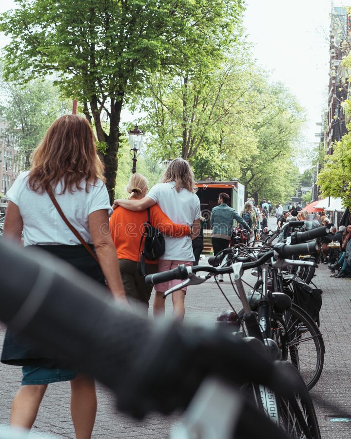 Tourists wandering happy through the beautiful streets of Amsterdam stock photos