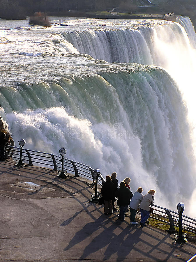 Tourists watching the magnificent waterfall Niagara Falls, USA stock photos