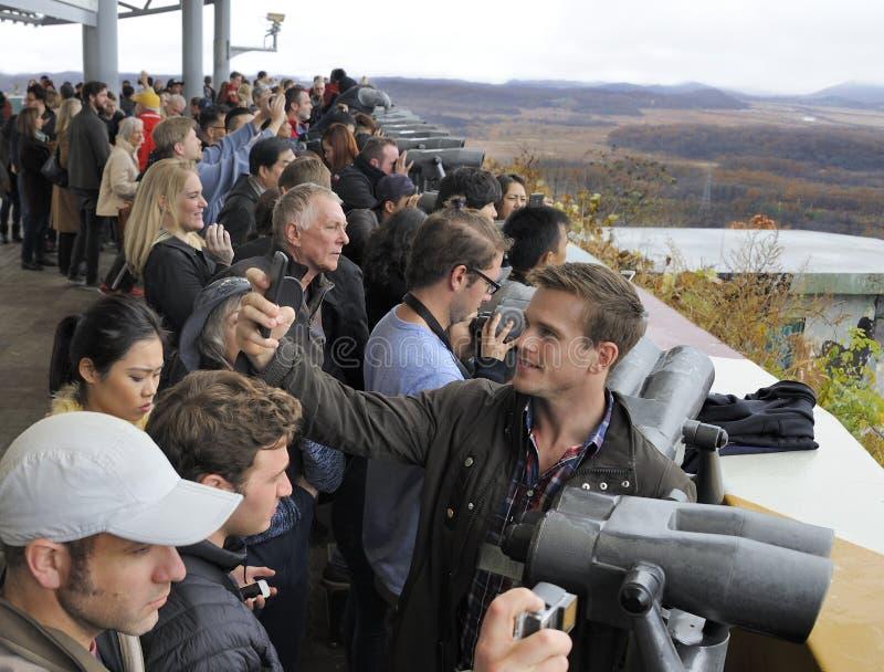Tourists watching North Korea. Imjingak, South Korea-November 14, 2015; DMZ Zone (South Korea): tourists watching North Korea with binoculars from the South stock image