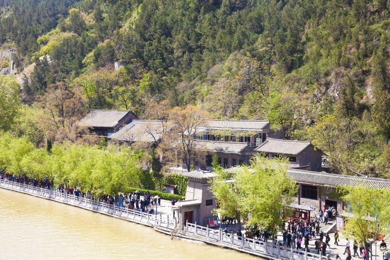 Tourists weave luoyang longmen grottoes stock photos