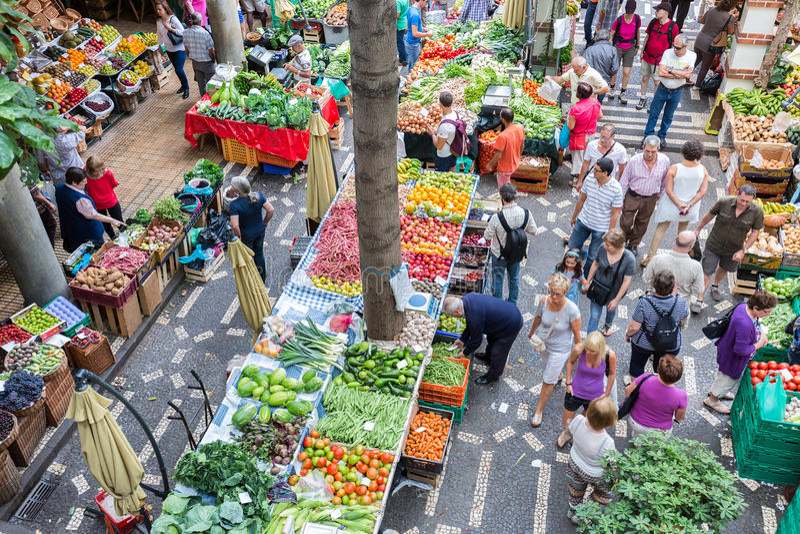 Tourits visiting the vegetable market Mercado dos Lavradores at Funchal, Madeira Island royalty free stock image
