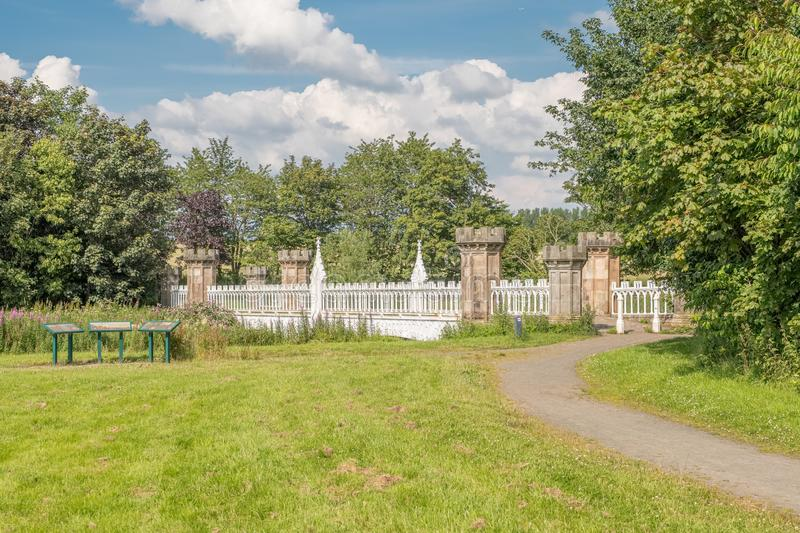 The Tournament Gothic Bridge with Baronial Piers and Iron Archetecture. Eglinton, Irvine Scotland. Irvine, Scotland, UK - July 15, 2019: Eglinton Park Autumn and royalty free stock images