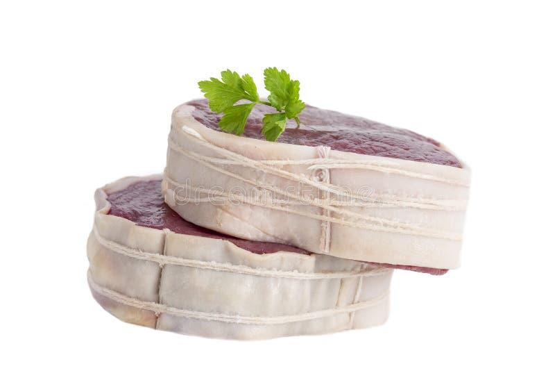 Tournedos: een kleine ronde dikke besnoeiing van een filet van rundvleeswit royalty-vrije stock afbeelding