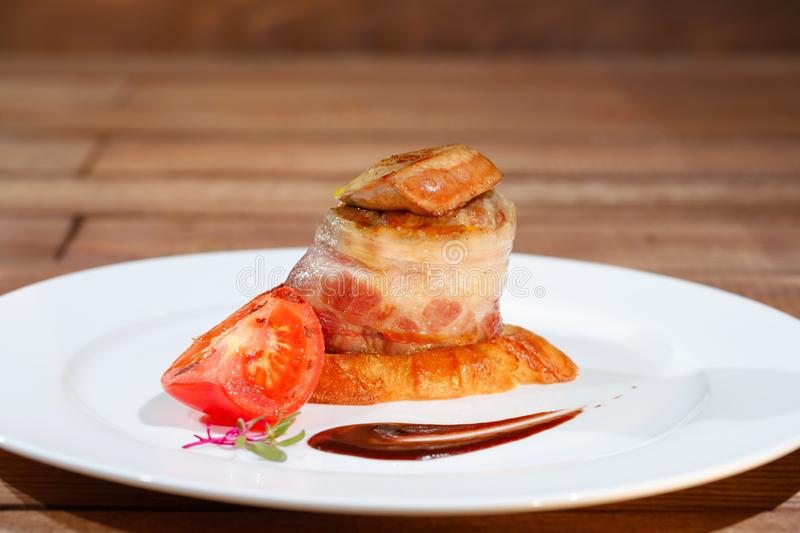 Tournedos Rossini. steak with foie gras. french steak dish with foie gras and croutons. royalty free stock images