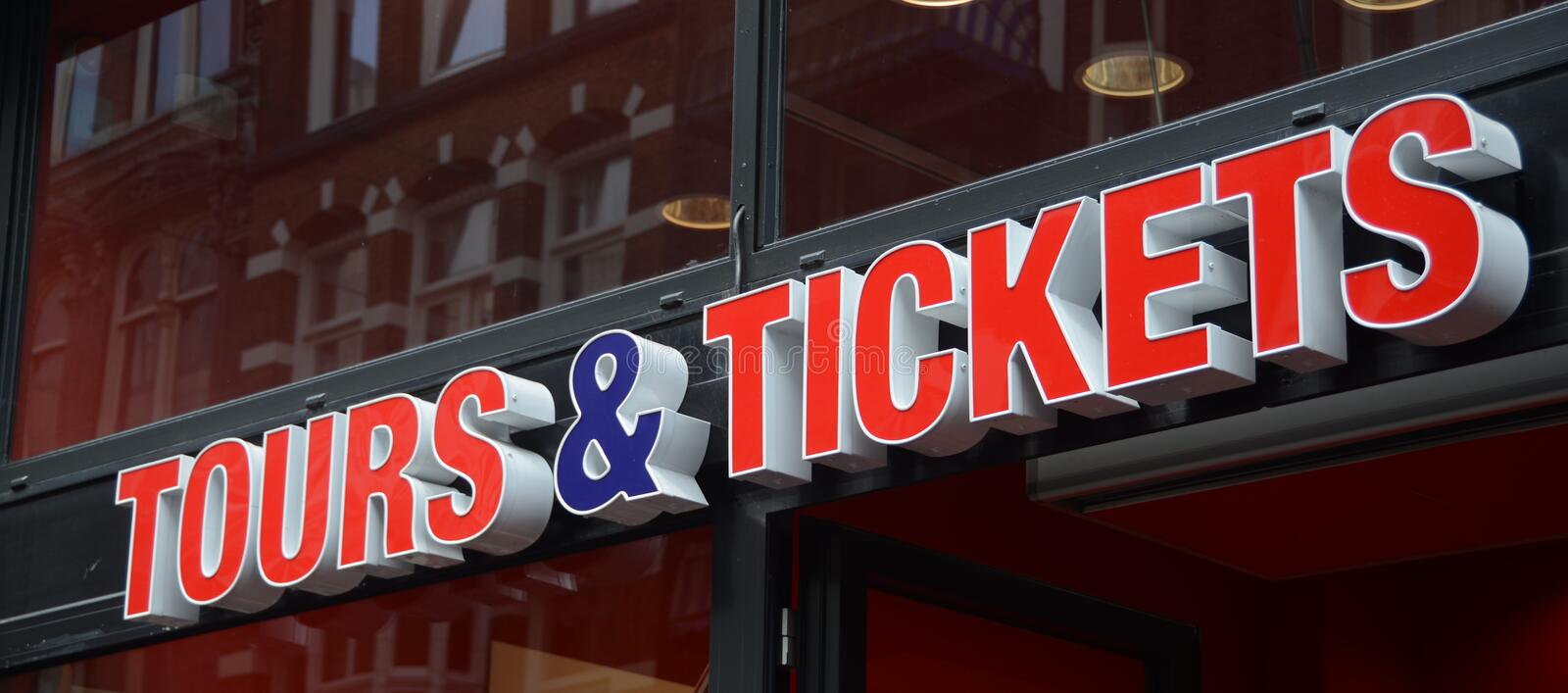 Tours and Tickets. Sign with word in red saying Tours & Tickets stock photos