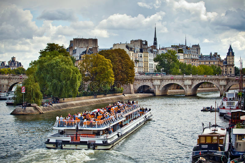 Toursit boat navigation on Seine river in Paris, France stock photography