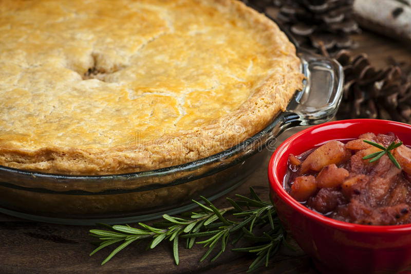 Tourtiere meat pie. Traditional pork meat pie Tourtiere with apple and cranberry chutney from Quebec, Canada stock images