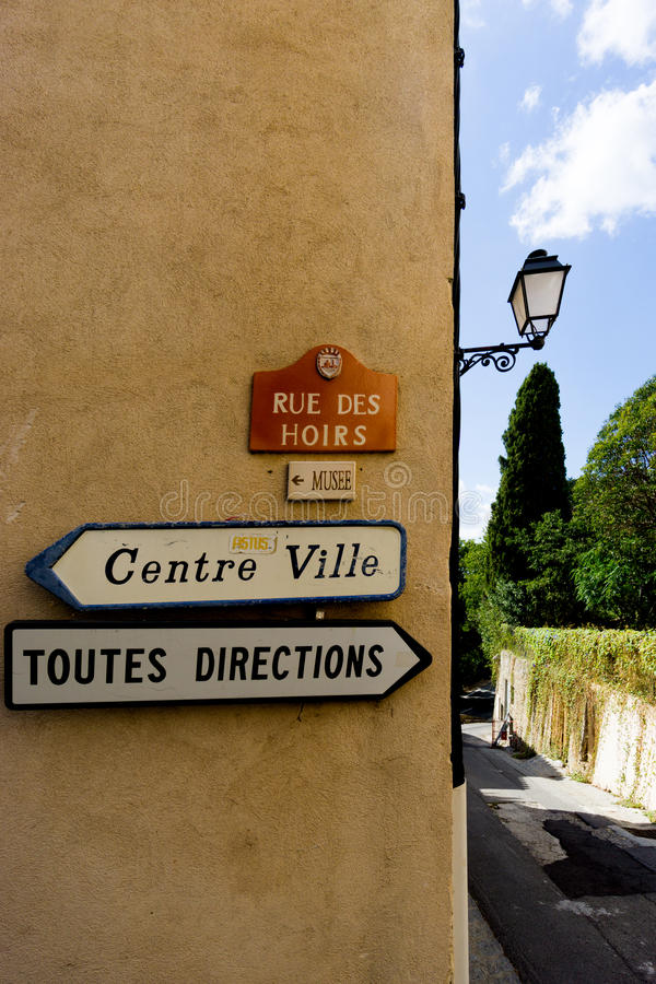 Toutes Directions and Centre Ville signs in the South of France village of Grimaud, Var, France royalty free stock photo