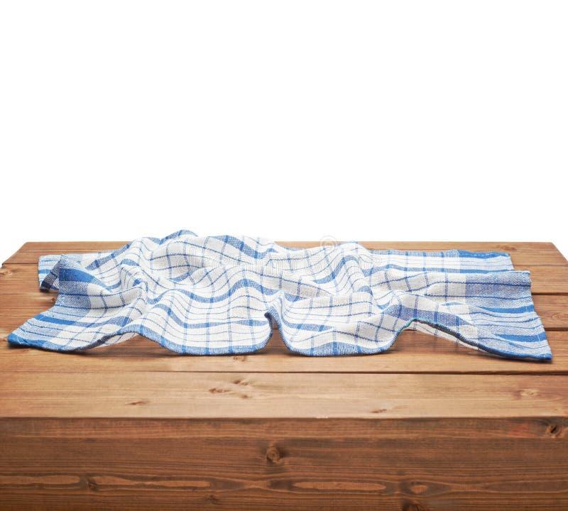 Tovaglia o asciugamano sopra la tavola di legno fotografia stock