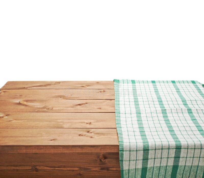 Tovaglia o asciugamano sopra la tavola di legno immagine stock libera da diritti