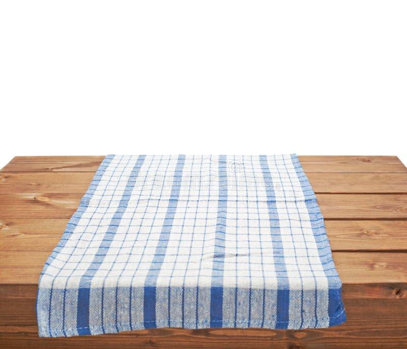 Tovaglia o asciugamano sopra la tavola di legno fotografie stock