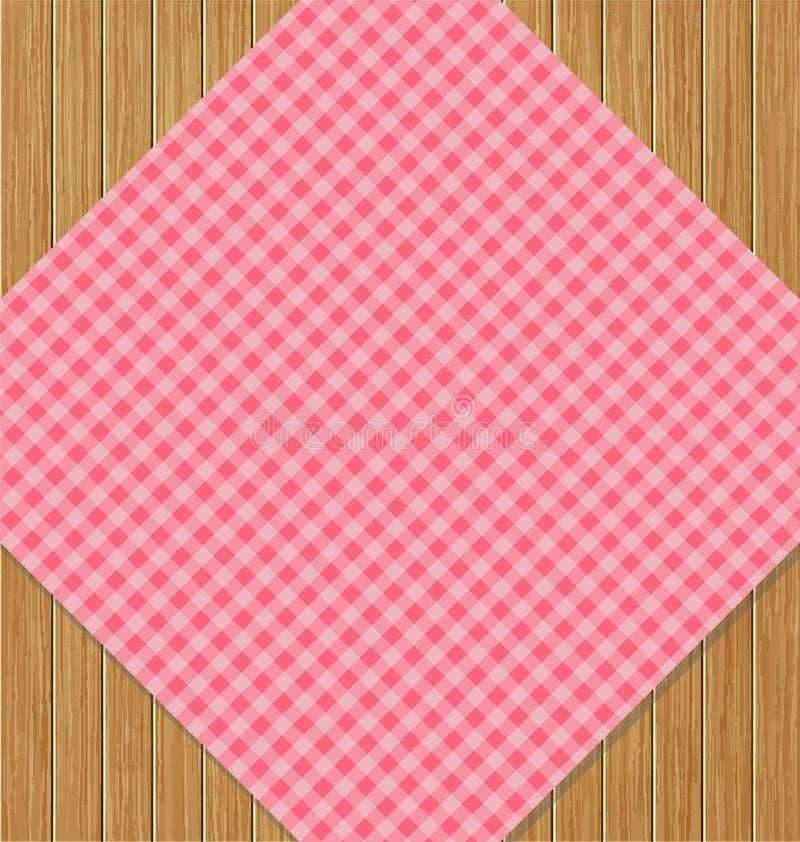 Tovaglia a quadretti rosa sulla Tabella di legno della quercia di Brown royalty illustrazione gratis