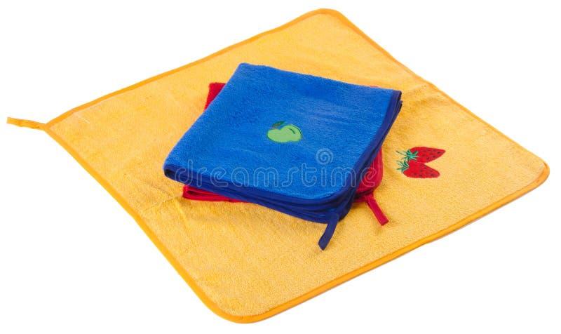 Tovagliolo di cucina in blu, nel colore rosso e nel colore giallo fotografia stock