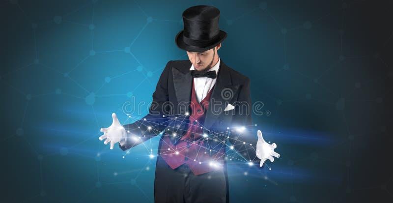 Tovenaar met geometrische verbinding op zijn hand royalty-vrije stock afbeelding