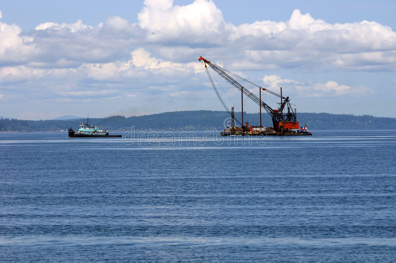 Tow ship and barge crane stock images