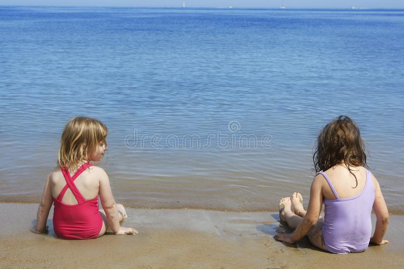 Download Tow Sisters Sit On Beach Bathing Suit Swimsuit Stock Photo - Image of seashore, bathing: 15585558