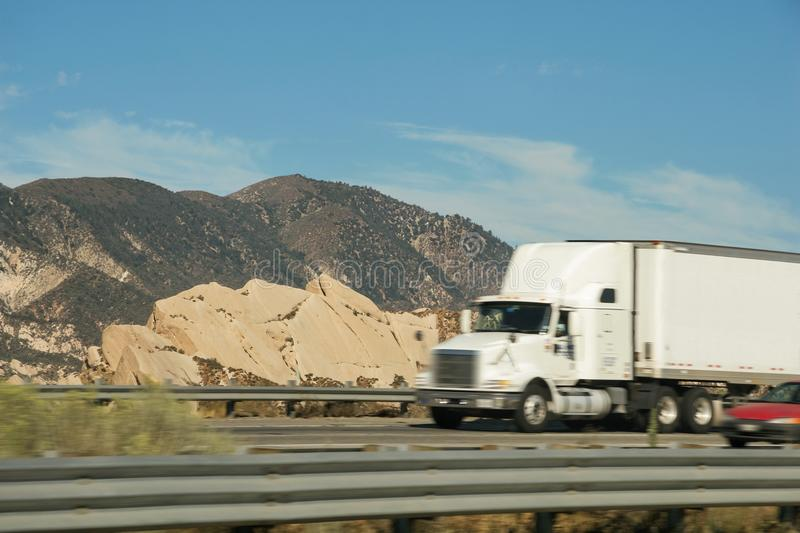 Tow truck and other vehicle circulating on Interstate Freeway 5 royalty free stock photos