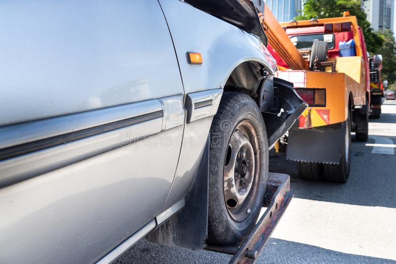 Tow truck towing a broken down car in emergency stock image