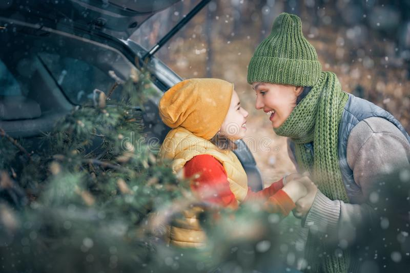 Mother, child and car on snowy winter nature royalty free stock photo