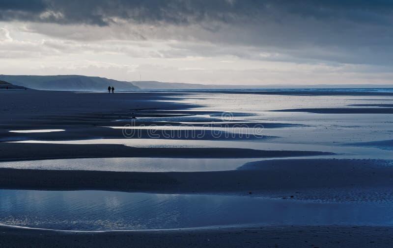 Towards Borth from Ynyslas - Colour. View towards Borth from Ynyslas, Ceredigion, Wales at low tide in January stock photos