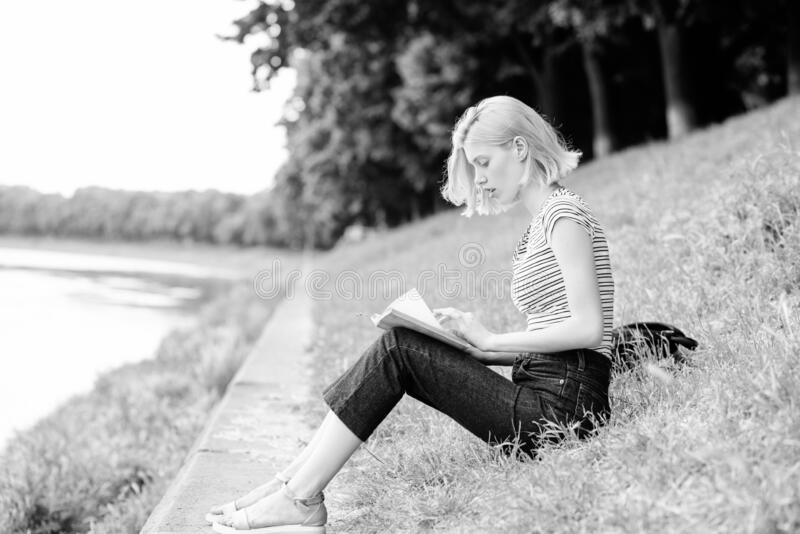 Towards knowledge. reading is my hobby. Summer study. interesting story. Relax and get new information. student girl. With book outdoor. inspired by novel royalty free stock photos