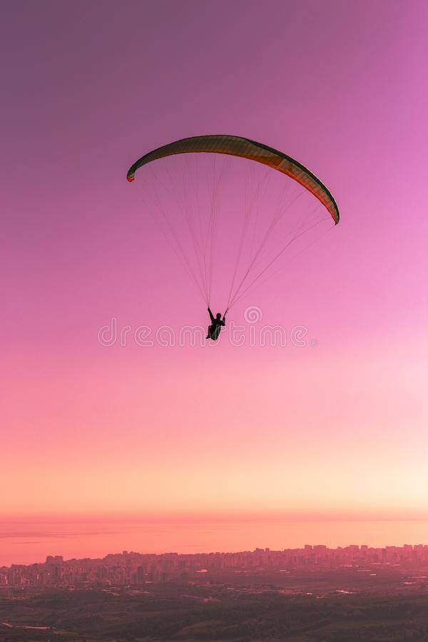 Towards to sunset... Landscape of fly freely in the sky. Paragliding is a sky sport. Towards to sunset... Paragliding is a sky sport. A paragliding can carry stock image