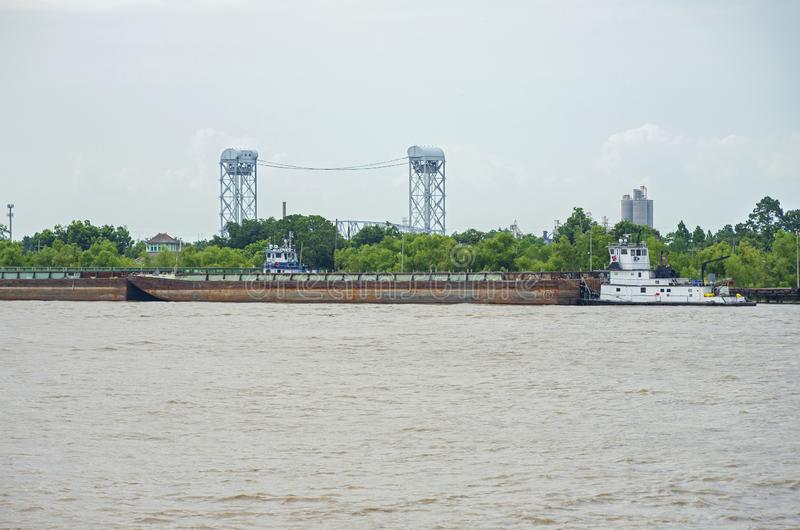Towboat Pushing Barges and Industrial Lock in New Orleans royalty free stock photography