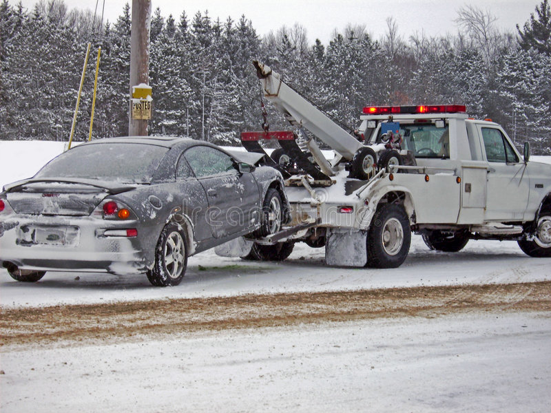 Download Wrecker Towing A Car In Winter Stock Image - Image: 5420911