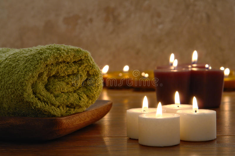 Towel and Aromatherapy Candles in a Spa stock images