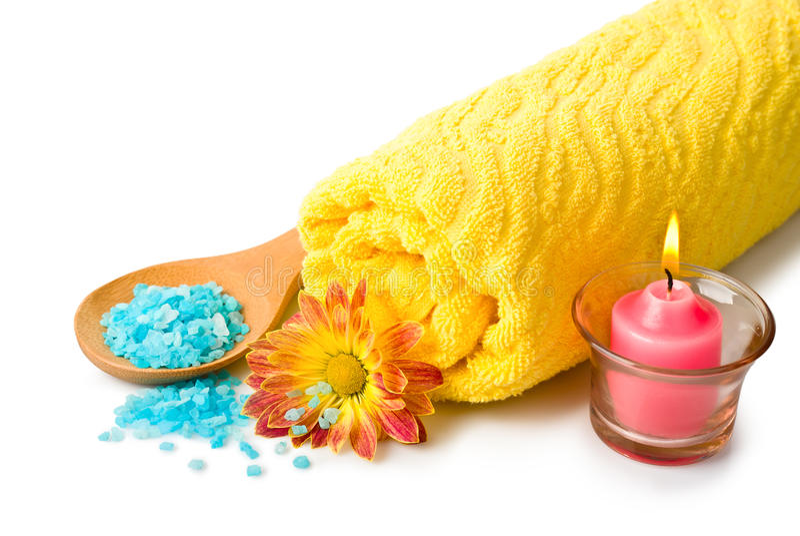 Towel, Blue bath salt, candle and flower stock images