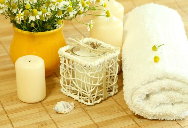 Download Towel, Candles And Camomile. Stock Photography - Image: 10799942