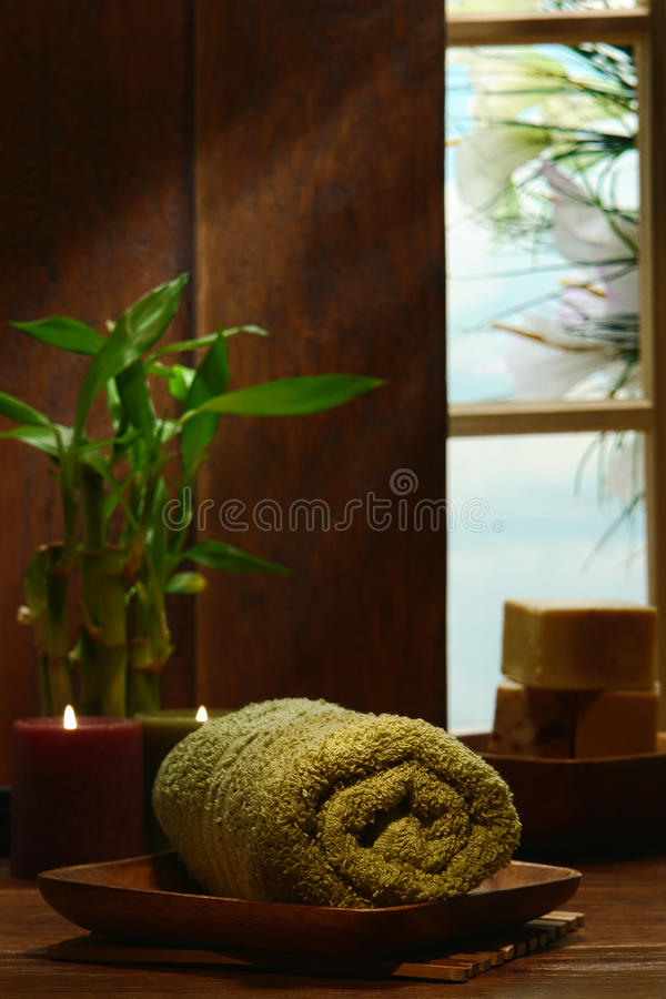 Towel and Candles in a Traditional Wood Decor Spa stock image
