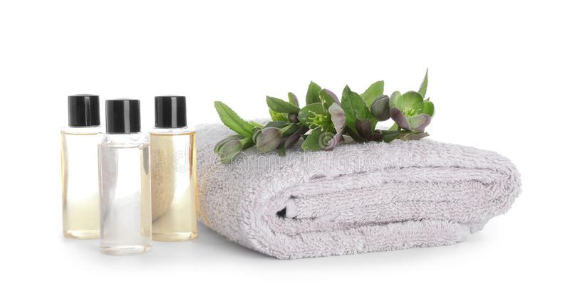 Towel, essential oils and flowers isolated. Spa treatment royalty free stock image